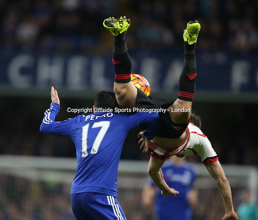 19 December 2015 Premier League Football - Chelsea v Sunderland : Billy Jones of Sunderland goes flying over Pedro.<br /> <br /> Photo: Mark Leech