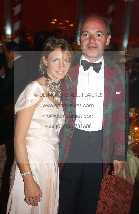 LUDOVIC LINDSAY and his wife at the 2004 Goodwood Revival ball this year theme was a Venetian Masked Ball, held at Goodwood Motor Racing circuit, West Sussex on 4t September 2004.