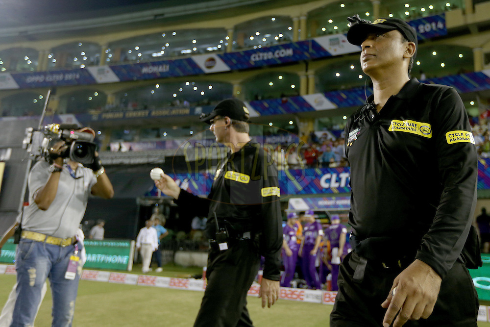 Umpires S Ravi and Ron Tucker walking out onto the field during match 2 of the Oppo Champions League Twenty20 between the Kings XI Punjab and the Hobart Hurricanes held at the Punjab Cricket Association Stadium, Mohali, India on the 18th September 2014. Photo by:  Jacques Rossouw / Sportzpics/ CLT20<br /> <br /> <br /> Image use is subject to the terms and conditions as laid out by the BCCI/ CLT20.  The terms and conditions can be downloaded here:<br /> <br /> http://sportzpics.photoshelter.com/gallery/CLT20-Image-Terms-and-Conditions-2014/G0000IfNJn535VPU/C0000QhhKadWcjYs
