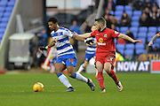 Reading FC striker Garath McCleary shields the ball from Blackburn Rovers midfielder Craig Conway during the Sky Bet Championship match between Reading and Blackburn Rovers at the Madejski Stadium, Reading, England on 3 December 2015. Photo by Mark Davies.