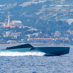The Wallypower 118 superyacht cruising at high speed of the coast of Italy.