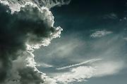 Approaching Storm Cloudscape with sunburst.