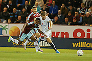 Milton Keynes Dons forward Dean Bowditch grapples with Burnley defender Tendayi Darikwa during the Sky Bet Championship match between Burnley and Milton Keynes Dons at Turf Moor, Burnley, England on 15 September 2015. Photo by Simon Davies.