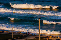 Waves crashing near Clore Beach along the Mediterranean Sea in Tel Aviv, Israel.