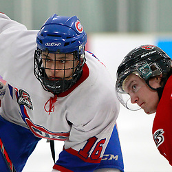 TORONTO, ON - Feb 16 : Ontario Junior Hockey League Game Action between the Milton Ice Hawks and the Toronto Jr. Canadiens, Ryan MacSpadyen #16 of the Toronto Jr. Canadiens Hockey Club and Ryan Burns #19 of the Milton Ice Hawks Hockey Club take the face-off.<br /> (Photo by Brian Watts / OJHL Images)