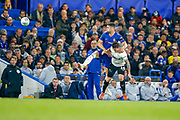 Chelsea defender Gary Cahill (24) climbs over Derby County forward Jack Marriott (14) to reach the ball during the EFL Cup 4th round match between Chelsea and Derby County at Stamford Bridge, London, England on 31 October 2018.