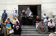 Egyptian patients wait for treatment outside the National Liver Institute in downtown Cairo, Egypt June 10, 2015. The Institute began treating Hepatitis C patients with direct-acting antiviral sofosbuvir last year as part of a large scale program that eventually hopes to lower Hepatitis C rates from 15% in Egypt down to just 2% within a decade. (Photo by Scott Nelson, for the New York Times)