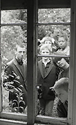 Young skinheads in window, High Wycombe, UK, 1980s.