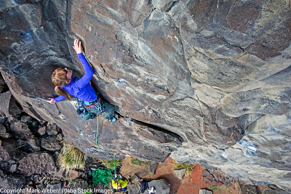 Mandi Eldridge rock climbing a route called Casual Cruise which is rated 5,10 and located on the North Shore at Dierkes Lake near the city of Twin Falls in southern Idaho