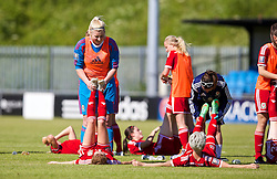 HAVERFORDWEST, WALES - Saturday, June 14, 2014: Wales players stretch after the FIFA Women's World Cup Canada 2015 Qualifying Group 6 match against Turkey at the Bridge Meadow Stadium. (Pic by David Rawcliffe/Propaganda)