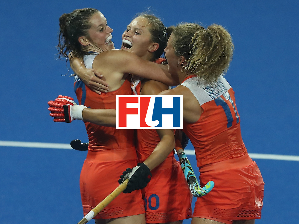RIO DE JANEIRO, BRAZIL - AUGUST 15:  Kelly Jonker (C) of the Netherlands celebrates with team mates Leidewij Welten (L) and Maria Verschoor after scoring their third goal during the Women's quarter final hockey match between the Netherlands and Argentina on Day10 of the Rio 2016 Olympic Games held at the Olympic Hockey Centre on August 15, 2016 in Rio de Janeiro, Brazil.  (Photo by David Rogers/Getty Images)