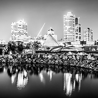 Milwaukee skyline at night photo in black and white. Picture includes the Milwaukee lakefront, Milwaukee Art Museum, University Club Tower, and Northwestern Mutual Tower. Photo is high resolution.