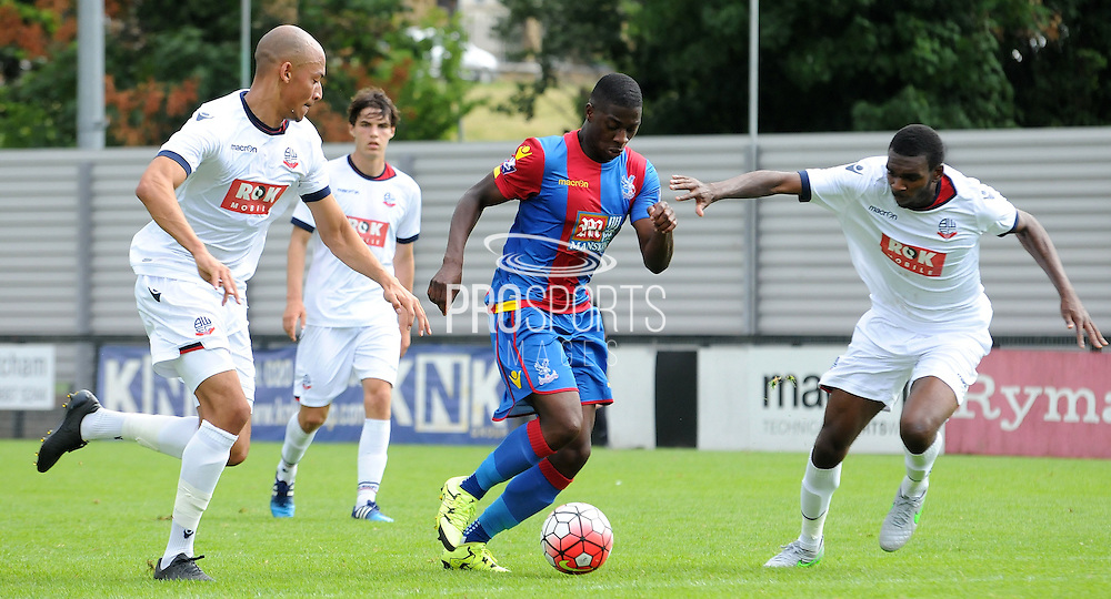 Sullay KaiKai charges forward during the U21 Professional Development League match between U21 Crystal Palace and U21 Bolton Wanderers at Selhurst Park, London, England on 17 August 2015. Photo by Michael Hulf.