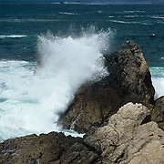 A single wave snaps against the rocks at Point Lobos State Reserve, CA.