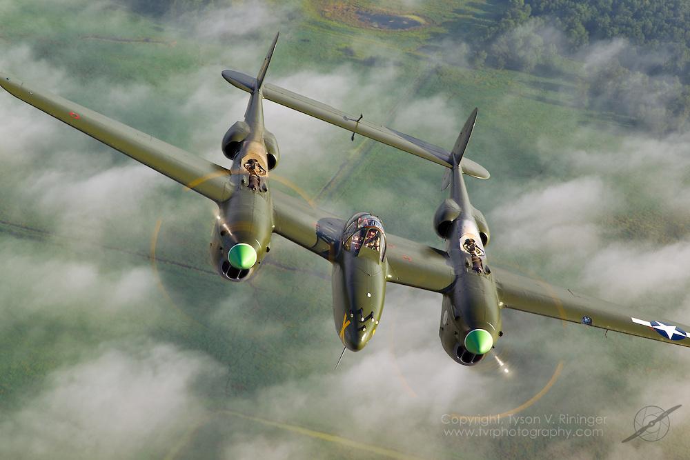 Rob Ator flies P-38 'Ruff Stuff' behind Larry Kelley's B-25 'Panchito'.