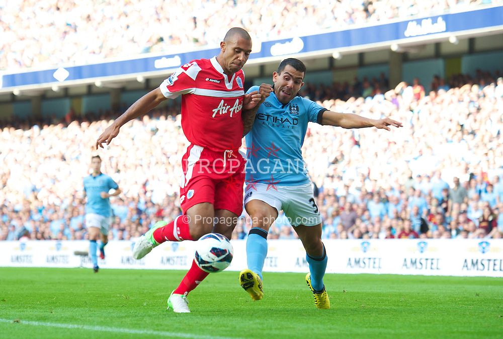 MANCHESTER, ENGLAND - Saturday, September 1, 2012: Manchester City's Carlos Tevez in action against Queens Park Rangers' Anton Ferdinand during the Premiership match at the City of Manchester Stadium. (Pic by David Rawcliffe/Propaganda)