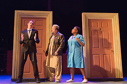 """© Licensed to London News Pictures. 08/10/2014. London, England. Pictured L-R: Steven Serlin as Rabbi, Kev Orkian as Mahmoud and Melanie Marshall as Zadie. The Musical """"The Infidel"""", based on the same named film by David Baddiel,  premieres at the Theatre Royal Stratford East, London. Directed by David Baddiel and Kerry Michael, book and lyrics by David Baddiel with music by Erran Baron Cohen. The Infidel is a story about Muslim man Mahmoud (Kev Orkian) who discovered that he is not only adopted but also Jewish. Photo credit: Bettina Strenske/LNP"""