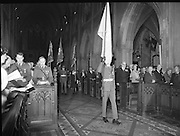 Remembrance Day Service.1983.13.11.1983.11.13.1983.13th November 1983..A remembrance service was held in St Patrick's Cathederal, Dublin,(Poppy Day) to commerate the Irish Fallen who died  whilst on service with the British Army in the two World Wars. Photo of an upstanding congregation as the colours,An Irish Army flag and the flags of the Royal British Legion,are trooped to the altar.