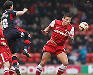 Picture by David Horn/Focus Images Ltd +44 7545 970036.23/02/2013.Charlie Macdonald of Leyton Orient is beaten to the ball by Matt Sparrow of Crawley Town during the npower League 1 match at the Matchroom Stadium, London.