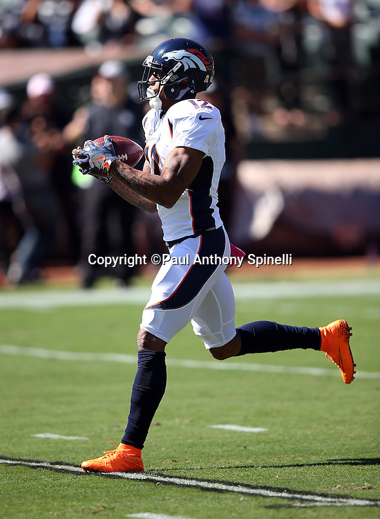 Denver Broncos wide receiver Andre Caldwell (12) catches a pregame pass while warming up before the 2015 NFL week 5 regular season football game against the Oakland Raiders on Sunday, Oct. 11, 2015 in Oakland, Calif. The Broncos won the game 16-10. (©Paul Anthony Spinelli)