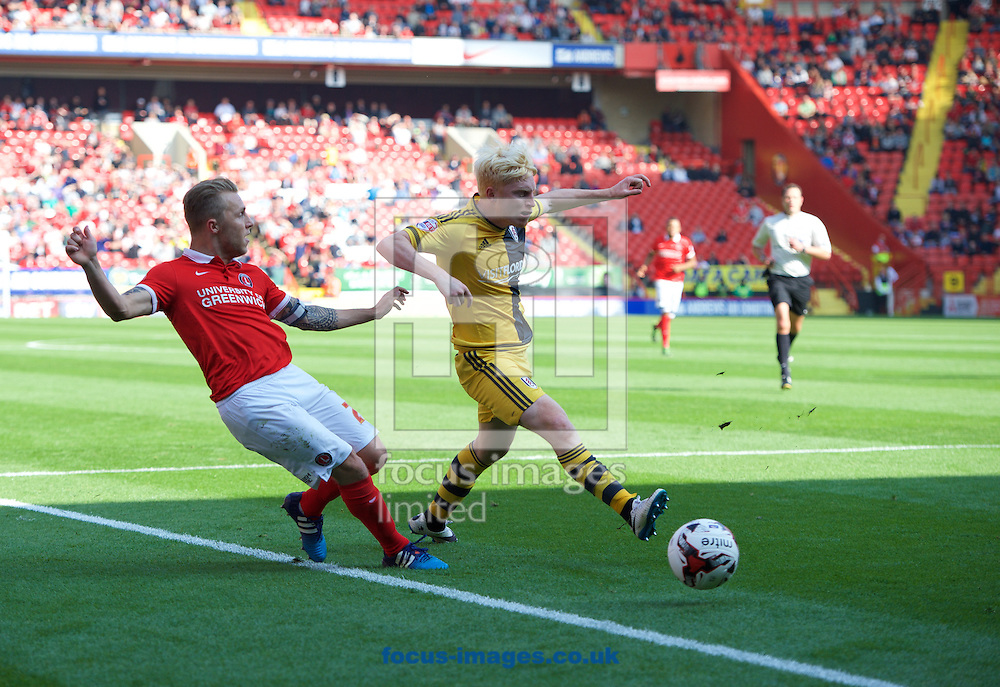 Chris Solly of Charlton Athletic and Cauley Woodrow of Fulham during the Sky Bet Championship match at The Valley, London<br /> Picture by Alan Stanford/Focus Images Ltd +44 7915 056117<br /> 04/10/2015