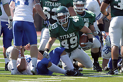17 September 2011: Cameron Blossom comes up from the bottom of a tackle pile during an NCAA Division 3 football game between the Aurora Spartans and the Illinois Wesleyan Titans on Wilder Field inside Tucci Stadium in.Bloomington Illinois.