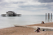 Brighton, East Sussex, England, UK, May 5 2019 - Tourists by the sea on the beach.