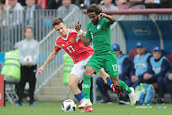June 14, 2018 - Moscow, Russia - Midfielder Aleksandr Golovin of Russia National team and defender Yasir Alshahrani of Saudi Arabia National team during the Group A match between Russia and Saudi Arabia at the 2018 soccer World Cup at Luzhniki stadium in Moscow, Russia, Tuesday, June 14, 2018. (Credit Image: © Anatolij Medved/NurPhoto via ZUMA Press)