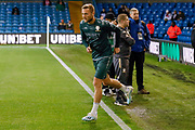 Leeds United defender Liam Cooper (6) leads his team out to warm up during the EFL Sky Bet Championship match between Leeds United and West Bromwich Albion at Elland Road, Leeds, England on 1 October 2019.
