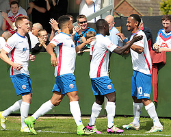 Nabil Shariff celebrates with team mates after scoring for AFC Rushden & Diamonds, to take the lead to make it 1 - 0 against Hanwell Town, during the Evo-stik South East match between AFC Rushden & Diamonds v Hanwell Town at Hayden Road ground on Saturday 12 August 2017..