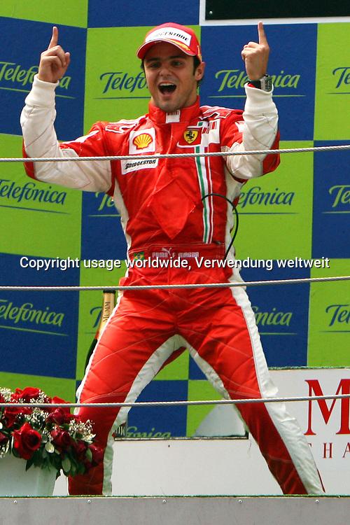 Brazilian Formula One driver Felipe Massa of Ferrari celebrates on the podium after he won the Grand Prix of Spain at the F1 race track Circuit de Catalunya in Montmelo near Barcelona, Spain, Sunday 13 May 2007. Photo: JENS BUETTNER +++(c) dpa - Report+++