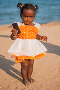 Little girl with cell phone (India)