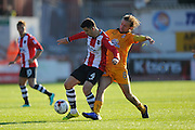 Lloyd James (4) of Exeter City battles for possession with Luke Berry (8) of Cambridge United during the EFL Sky Bet League 2 match between Exeter City and Cambridge United at St James' Park, Exeter, England on 22 October 2016. Photo by Graham Hunt.