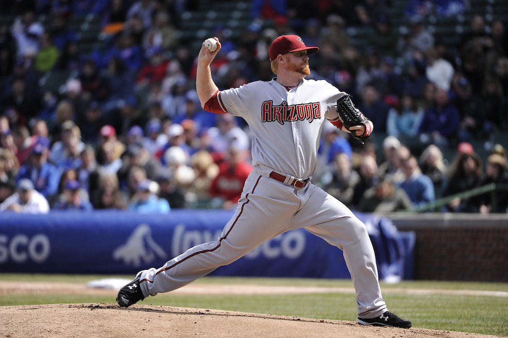 CHICAGO - APRIL  05:  Barry Enright #54 of the Arizona Diamondbacks pitches against the Chicago Cubs on April 5, 2011 at Wrigley Field in Chicago, Illinois.  The Cubs defeated the Diamondbacks 6-5.  (Photo by Ron Vesely) Subject: Barry Enright