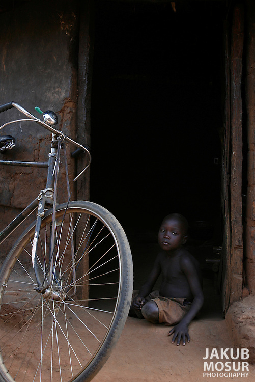 October 6, 2006 - A child sits at his home in Coope camp for internally displaced people, or IDP, near Gulu in north Uganda. Coope, with a population of 18,000, is one of 76 IDP camps around Gulu, the main base for the Uganda Peoples Defense Force fighting the insurgent Joseph Kony's Lord's Resistance Army. Kony's LRA movement has been fighting for the past 20 years to force the East African country to be ruled according to the Christian Ten Commandments. Over 2 million people, mostly of the Acholi tribe, have moved or were forced to move from their villages to camps close to the towns of Gulu, Lira, and Kitgum where they are watched over by the Ugandan Army. The LRA rebels have abducted thousands of children and have forced them to fight against the Ugandan Army and the Acholi people. Current peace talks between Kony's LRA and the Ugandan government held in Juba, southern Sudan, offer a glimpse of hope to ending this ongoing conflict..(Photo by Jakub Mosur/Polaris)<br />