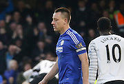An upset Chelsea defender John Terry after his own goal during the Barclays Premier League match between Chelsea and Everton at Stamford Bridge, London, England on 16 January 2016. Photo by Andy Walter.