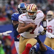 San Francisco 49ers quarterback Colin Kaepernick in action during the New York Giants V San Francisco 49ers, NFL American Football match at MetLife Stadium, East Rutherford, NJ, USA. 16th November 2014. Photo Tim Clayton