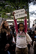A young girl and her mother protest in Zuccotti Park in downtown Manhattan during the Wall Street protests.