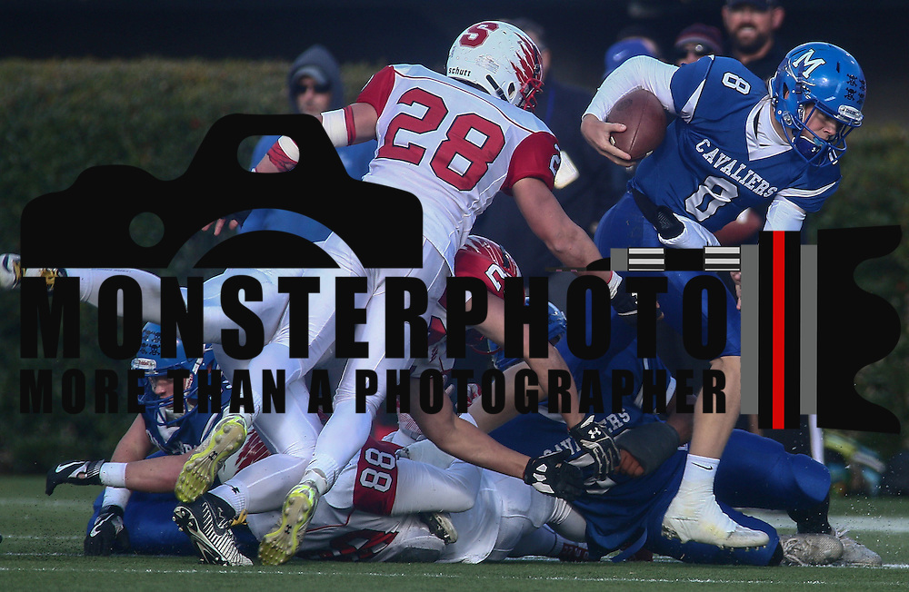 Middletown quarterback Drew Fry (8) attempts to escape a tackle during the DIAA division one Football Championship game between Top-seeded Middletown (11-0) and second-seeded Smyrna (11-0) Saturday, Dec. 03, 2016 at Delaware Stadium in Newark.