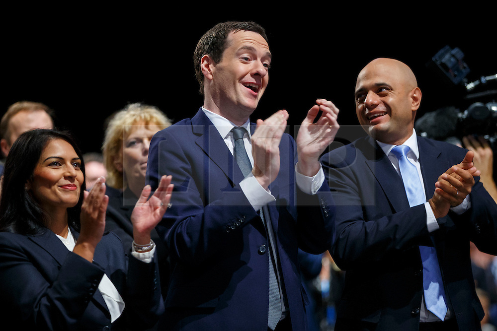 © Licensed to London News Pictures. 07/10/2015. Manchester, UK. PRITI PATEL, GEORGE OSBORNE and SAJID JAVID listening Prime Minister David Cameron speaking at Conservative Party Conference at Manchester Central convention centre on Wednesday, 7 October 2015. Photo credit: Tolga Akmen/LNP