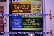 Extinction Rebellion activists put up posters at the office of Environment Secretary and the Member of Parliament for Camborne in Cornwall, George Eustice MP, to protest against his environmental record on 25th June 2020 in St Ives, United Kingdom. On the same day the Climate Change Committee will deliver it's progress report to the Government, XR believe that the government is failing in its commitments to reach net zero emissions by 2050, a target they see as already woefully inadequate. They also believe that it will say they are failing in their responsibilities to keep people safe. They are demanding our MPs force the government to take immediate preventative action to avoid climate collapse by implementing a covid recovery plan that achieves net zero carbon emissions by 2025.