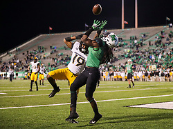 Nov 25, 2017; Huntington, WV, USA; Marshall Thundering Herd wide receiver Willie Johnson (1) and Southern Miss Golden Eagles defensive back Curtis Mikell (19) jump for a pass in the end zone during the fourth quarter at Joan C. Edwards Stadium. Mandatory Credit: Ben Queen-USA TODAY Sports