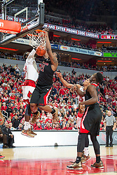 North Carolina State forward Beejay Anya, right. <br /> <br /> The University of Louisville hosted the North Carolina State, Saturday, Feb. 14, 2015 at the Yum Center in Louisville. NC State won 74-65.<br /> <br /> Photo by Jonathan Palmer