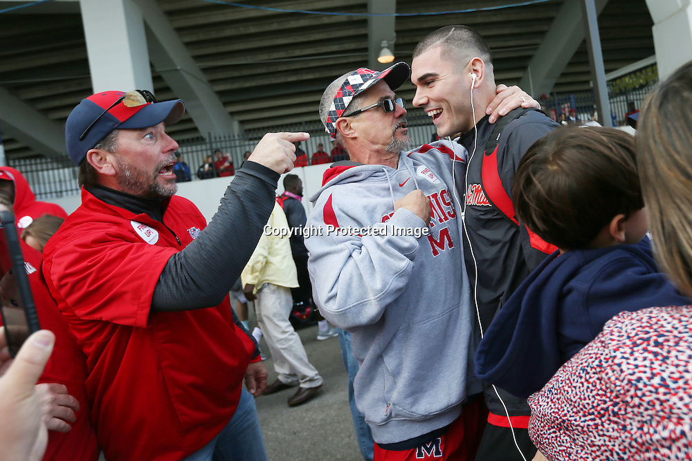 Lauren Wood | Buy at photos.djournal.com<br /> Darin Farley, left, of Barton, Miss. and Todd Morris of Collierville, Tenn., pump Chad Kelly up after the team got off the bus Saturday morning before the University of Memphis game in Memphis.