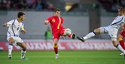 LLANELLI, WALES - Wednesday, August 15, 2012: Wales' Gareth Bale in action against Bosnia-Herzegovina's captain Emir Spahic and Boris Pandza during the international friendly match at Parc y Scarlets. (Pic by David Rawcliffe/Propaganda)