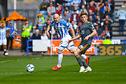 Aaron Mooy of Huddersfield Town (10) and Harvey Barnes of Leicester City (19) in action during the Premier League match between Huddersfield Town and Leicester City at the John Smiths Stadium, Huddersfield, England on 6 April 2019.