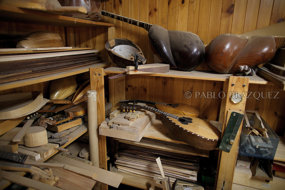 10/08/2016. Details of the workshop where Luthiers are making instruments from medieval times on August 10, 2016 in Pelayos de la Presa, Madrid province, Spain. The Collegiate of Santa María la Mayor is a Romanesque architecture church built during the 12th and 13th centuries. Recents restorations of the Church discovered many details on its sculptures, and luthiers found the opportunity of recovering and to reproduce instruments showing on its North gate. (© Pablo Blazquez)