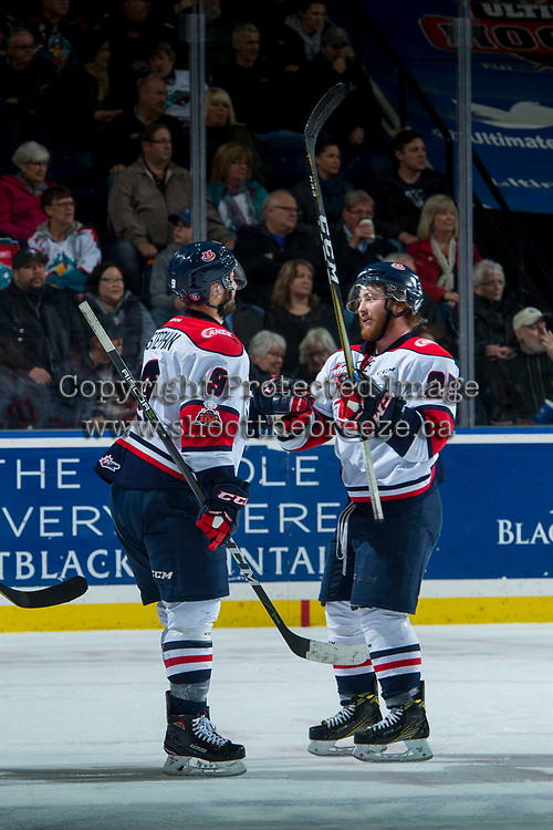 KELOWNA, CANADA - NOVEMBER 17: Giorgio Estephan #9 fist bumps Zane Franklin #25 of the Lethbridge Hurricanes to celebrate his second goal of the second period against the Kelowna Rockets on November 17, 2017 at Prospera Place in Kelowna, British Columbia, Canada.  (Photo by Marissa Baecker/Shoot the Breeze)  *** Local Caption ***
