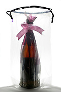 pink bow gift wrapped bottle in transparent bag