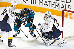 January 8, 2011; San Jose, CA, USA; Nashville Predators goalie Pekka Rinne (35) stops a shot from San Jose Sharks center Jamal Mayers (10) during the first period at HP Pavilion. Mandatory Credit: Jason O. Watson / US PRESSWIRE